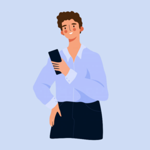A man with curly brown hair is wearing a light blue button-down shirt. His cheeks are flushed and he's smiling as he looks at his phone.